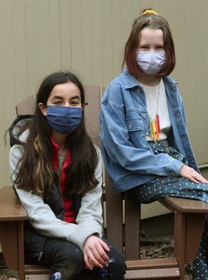 Zoey Frank, left, and Willa Nelson are among nine students from Gordon School in East Providence, R.I., who joined a field trial of the Moderna vaccine's effect on 12-to-17-year-olds.
