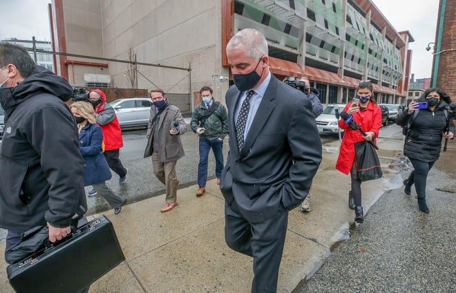 Providence police Sgt. Joseph Hanley leaves District Court in Providence after being convicted of simple assault over his treatment of a handcuffed man last April.