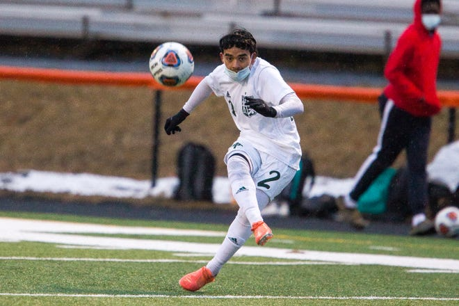 Boylan's Jovanni Ramos sends a pass to midfield against Harlem in the first half of their NIC-10 match at Harlem High School on Wednesday, March 17, 2021, in Machesney Park.