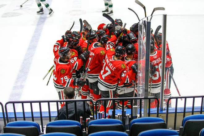 The Rockford IceHogs celebrate a recent overtime victory. Their games against Iowa on Friday and Saturday were pushed to Sunday and Monday due to COVID-19 protocols.