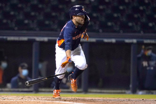 Houston Astros' Jose Altuve runs after hitting a single during the third inning of a spring training baseball game against the Washington Nationals on March 9 in West Palm Beach, Fla.