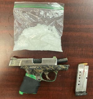 Investigators say they seized methamphetamine and a gun from a Grover couple's car during a traffic stop.