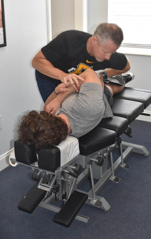 Sarasota's Dr. Ken Kaufman, shown here working on a patient, has for 11 years been the spring training chiropractor for the Baltimore Orioles. He recently took that same position with the Pittsburgh Pirates.