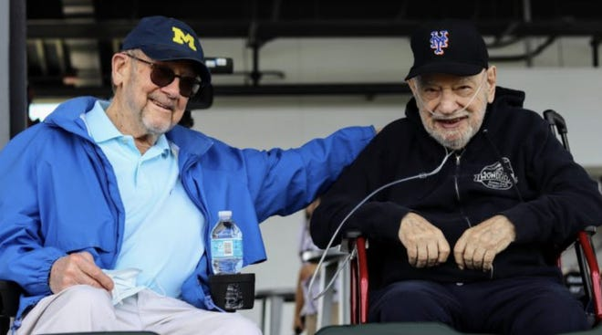 Bill Berliner, right, sits with friend Walter Risse last week at CoolToday Park in North Port for a spring training baseball game between the host Atlanta Braves and Tampa Bay Rays.