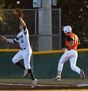 Venice's Aidan Corn gets a late throw at first base as Sarasota's Kyle Manitz is safe at first base during the first inning of play at Venice High School Wednesday night March 17, 2021.