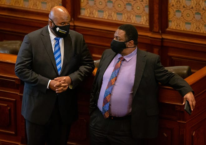 Illinois State Sen. Elgie R. Sims, Jr., D-Chicago, left talks with Illinois State Sen. Emil Jones III, D-Chicago, right, during debate on SB1863, a bill dealing with vote by mail and other changes for the 2020 election, on the floor of the Illinois Senate during session at the Illinois State Capitol, Friday, May 22, 2020, in Springfield, Ill. [Justin L. Fowler/The State Journal-Register]