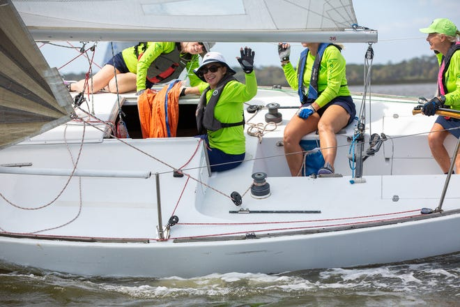 """The all-female crew of the """"Hulamoon"""" races in the Geechee Sailing Club's 2020 St. Patrick's Regatta."""