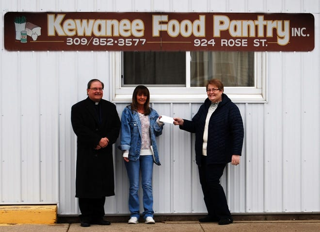 The Ladies Adoration Society of the Holy Trinity Polish National Catholic Church donated $500 to the Kewanee Food Pantry. From left: Father John Cramer, new pastor of Holy Trinity Church; Lisa Janey of the Kewanee Food Pantry; and presenting the check, Lynn Van Hyfte, president of the Ladies Adoration Society.