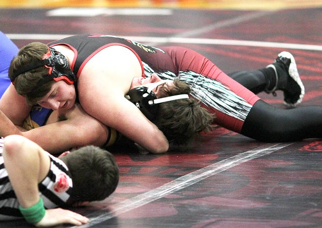 Luke Gropp pins Morgan Taylor of Centreville at 189 pounds on Wednesday evening.