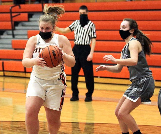 Rylee Wanamaker corrals a loose ball against Three Rivers on Wednesday.
