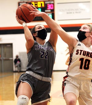 Kali Heivilin of Three Rivers muscles her way in to score two points against Sturgis on Wednesday evening.
