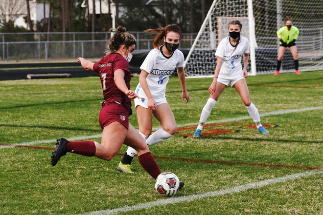 (7) Mackenzie Milliman shoots as Ashley's girls soccer hosts Hoggard Wendesday night.  March 17, 2021.  [KEN OOTS/FOR STARNEWS]