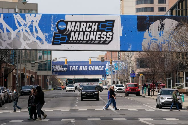 March Madness banners for the NCAA college basketball tournament cover crosswalks in downtown Indianapolis.