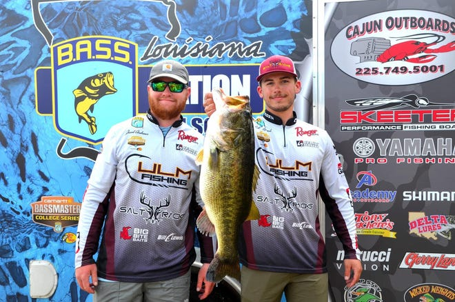 De Soto, Kan., product Connor Nimrod, right, holds up an 11-pound largemouth bass that earned himself and Louisiana-Monroe teammate Jacob Andrews the big fish award and a state title on March 14 at the Louisiana BASS Nation College State Championship on Caney Lake in Chatham, La.