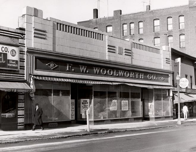 Signs in the window of this closed Woolworth store on Main Street in Worcester direct shoppers to the large Woolworth on Front Street, across from Worcester Common. This photo is dated Feb. 26, 1957.