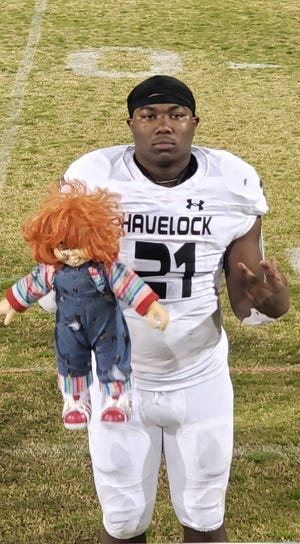 Havelock senior running back and UNC commit Kamarro Edmonds posed with this Chucky doll after the Rams' 56-7 road win at Wallace-Rose Hill on March 5.