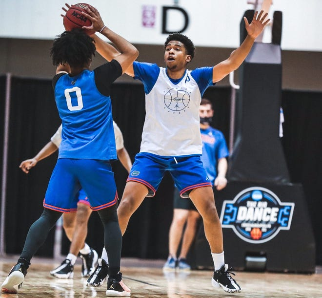Florida guards Ques Glover (0) and Noah Locke get in some practice time in Indianapolis ahead of Friday's NCAA Tournament first-round game vs. Virginia Tech.