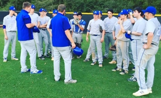 An elated Saint Francis baseball team huddles Wednesday after its win over arch-rival Oak Hall.