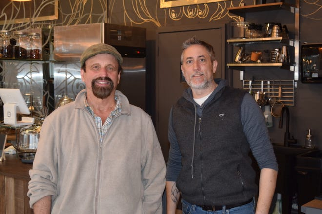 Chuck Beard (left) and Terry Miller pose inside The Gilded Bean.