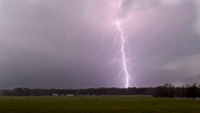 Lightning flashes moments before a tornado touched down in Moundville in Hale County Ala.,, March 17, 2021, causing damage to homes and downing trees in Moundville and Tuscaloosa County.