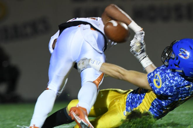 Serrano's Nathan Sandoval, right, forces a fumble against Apple Valley in the fourth quarter of a game on Oct. 11, 2019.