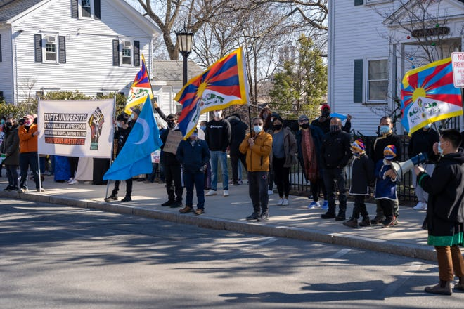 Over 100 people joined the March 13 protest outside Tufts' Confucius Institute.