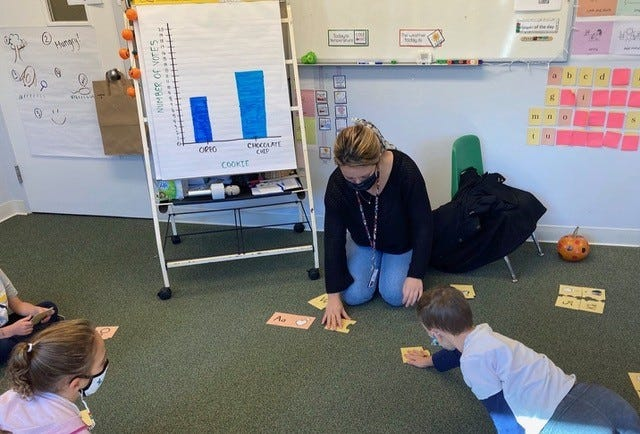 Children practicing matching picture cards and letter sounds.