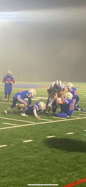 A gang of Madison Patriots' defensive players swarmed the Polk County ball carrier in the Patriots' 53-7 loss in Marshall on March 12.
