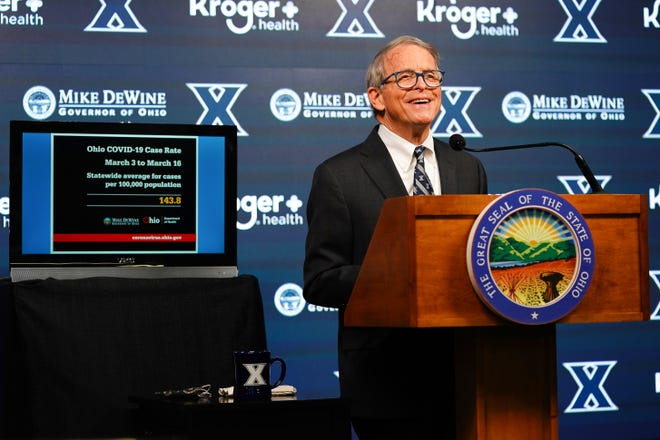 Ohio Gov. Mike DeWine delivers his daily coronavirus briefing after touring the pop-up mass vaccination center, Thursday, March 18, 2021, at Cintas Center in Cincinnati.