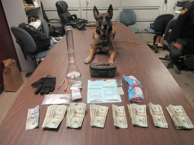 K-9 Officer Chili with suspected drugs, drug-related items and money recovered from an during Thursday morning traffic stop. One woman and one man were taken into custody.