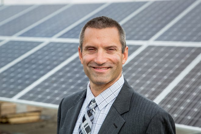 General Motors' Rob Threlkeld in the solar array field at GM Warren Transmission Operations Thursday, September 8, 2016 in Warren, Michigan. (Photo by Jeffrey Sauger for General Motors)