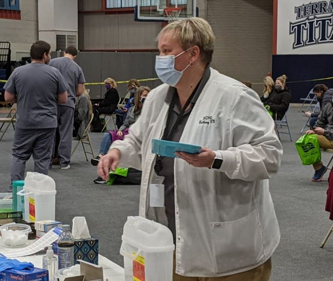 Bethany Brown, Sandusky County Health Commissioner, works during a Feb. 24 school vaccine clinic where educators from around the county were vaccinated at Terra State Community College.