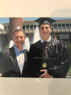 Ryan Modell, right, with his father, Sandy, on graduation day at the University of Central Florida.