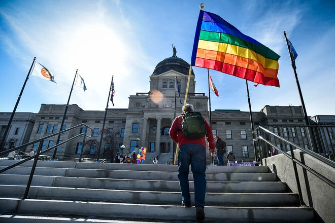 FILE - In this March 15, 2021, file photo demonstrators gather on the step of the Montana State Capitol protesting anti-LGBTQ+ legislation in Helena, Mont. The Montana Senate Judiciary Committee voted Thursday, March 18 to advance two bills targeting transgender youth despite overwhelming testimony opposing the measures. The measures would ban gender affirming surgeries for transgender minors and ban transgender athletes from participating in school and college sports. Both bills have already passed the Montana House. They head next to votes by the GOP-controlled Montana Senate.  (Thom Bridge/Independent Record via AP, File)