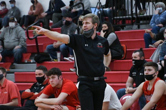 Alex Eversole, shown coaching in the Falcons' Division II tournament game at Sheridan last month, has resigned as the boys basketball coach after leading the Falcons to 116 wins over the last seven seasons.