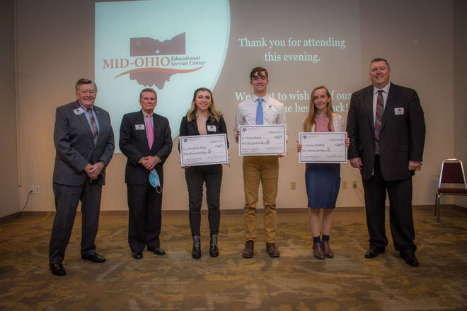 The Mid-Ohio Educational Service Center recently presented its Franklin B. Walter Scholarship Awards. From left, Mid-Ohio Board of Governors President Dick Theaker, Vice President Doug Theaker, Highland Local's Annabelle Zerby, Galion City's Simon Shawk, Lexington Local's Joanna Halfhill, and Mid-Ohio ESC Superintendent Kevin D. Kimmel