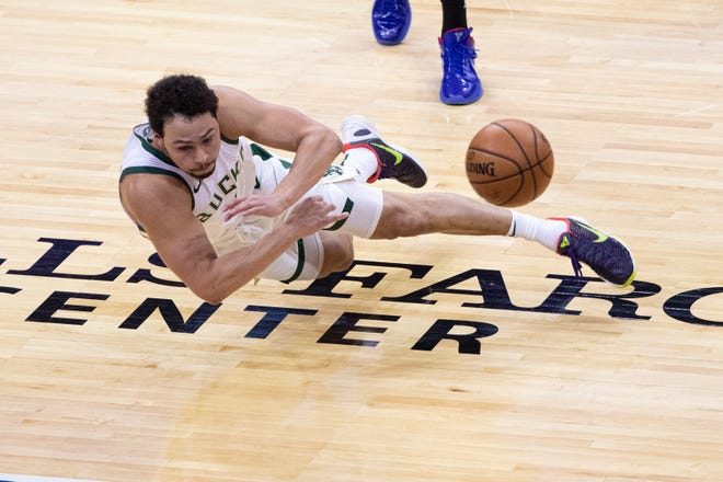 Bucks guard Bryn Forbes dives to save a ball headed out of bounds during the second quarter.