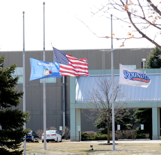 The flags were flying at half-staff at the Roundy's warehouse in Oconomowoc on March 18. Two employees were killed at the warehouse March 16. Authorities say the suspect committed suicide after the shootings.