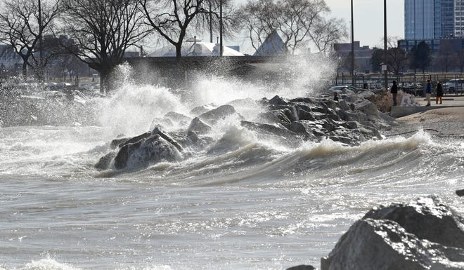 Waves from the high wind gusts crash on the Lake Michigan shore near McKinley Park in Milwaukee on March 18, 2021.
