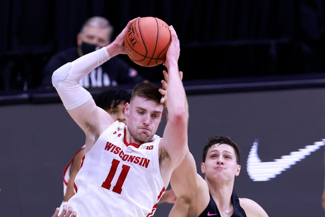 Wisconsin's Micah Potter rebounds the ball over Penn State's John Harrar during a game March 11 in Indianapolis.