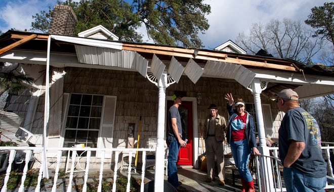George Cook, left, and his daughter Carol Carter check the storm damage at his home near Billingsley, Ala., on March 18, 2021, after overnight storms hit the area.