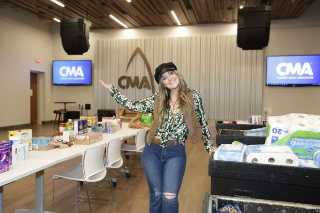 Lainey Wilson attends CMA's Music Industry COVID Support (MICS) food drive to benefit Musically Fed on March 17, 2021, at the CMA offices in Nashville, Tenn.