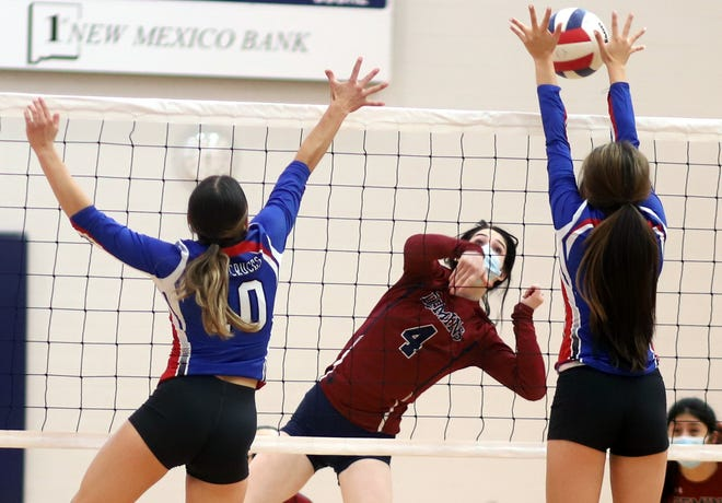 Senior Lady 'Cat outside hitter Sierra Manos (4) attempts to split the Las Cruces block during Wednesday's District 3-5A volleyball match against the Bulldawgs. Las Cruces High came away with a three-game sweep of the best-of-five match.