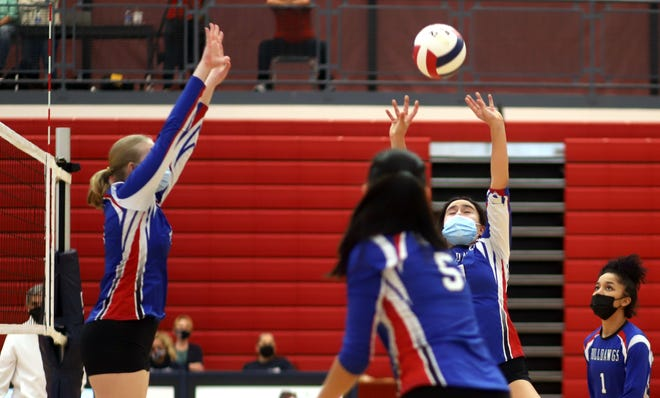 Senior setter Lina Figueroa sends the ball toward the net for another assist during Wednesday's Las Cruces High volleyball win at Deming High. The Bulldawgs defeated the Lady Wildcats 25-20, 25-20 and 25-17 in a District 3-5A match.