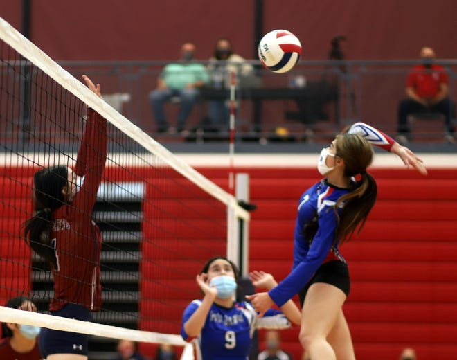 Las Cruces High's Isabella Barrera pounds at the Deming defense during Las Cruces High's 25-20, 25-20 and 25-17 victory at Deming High on Wednesday.