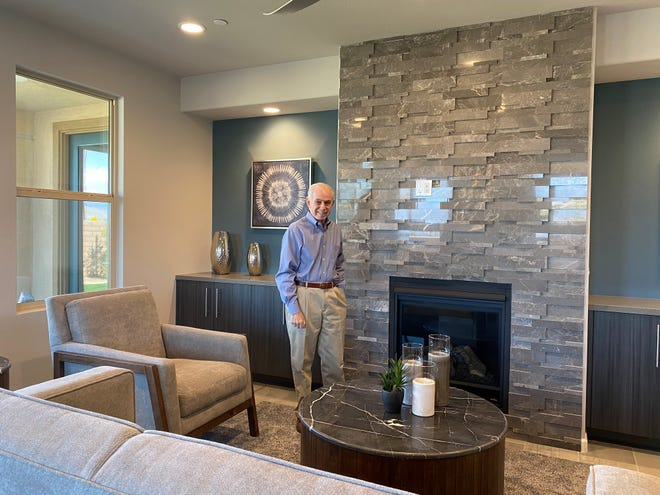 Mitch Blumberg surveys the living room of the house he won March 9, 2021, in the St. Jude Dream Home Giveaway drawing.