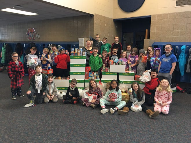 Third graders from Robert Bennis Elementary show their collected items for the Brandon food pantry.