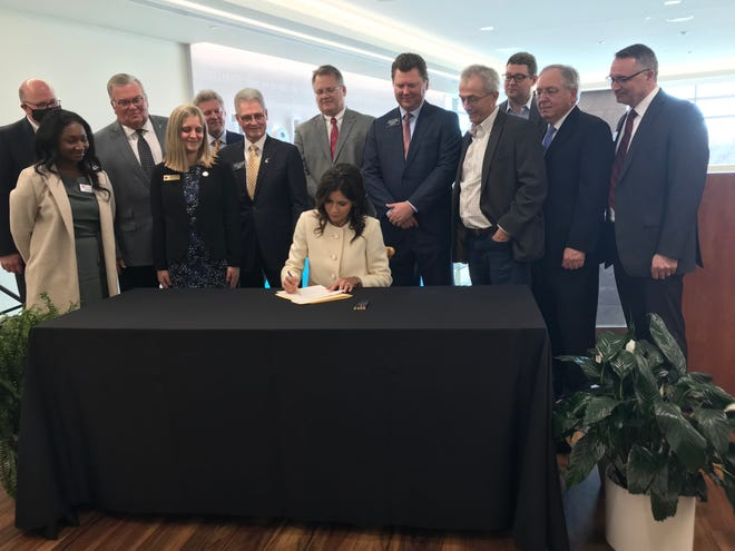 Gov. Kristi Noem Thursday was joined by lawmakers, bankers and health officials in Sioux Falls for a ceremonial bill signing to establish the state's first-ever needs-based scholarship.