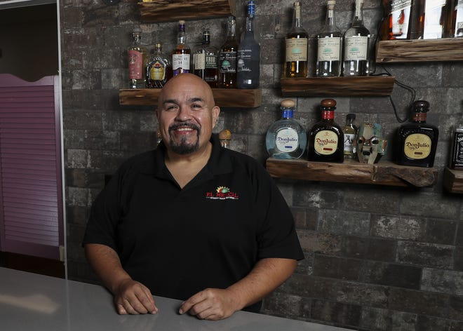 Restaurant owner Adolfo Melendez stands behind the bar on Thursday, March 18, 2021, at El Mezcal in Stevens Point, Wis. Melendez has spent more than $3000 of his own advertising budget to purchase gift cards to other local restaurants and raffled them off to his customers. His story will also be featured on The Kelly Clarkson show on April 1.  Tork Mason/USA TODAY NETWORK-Wisconsin