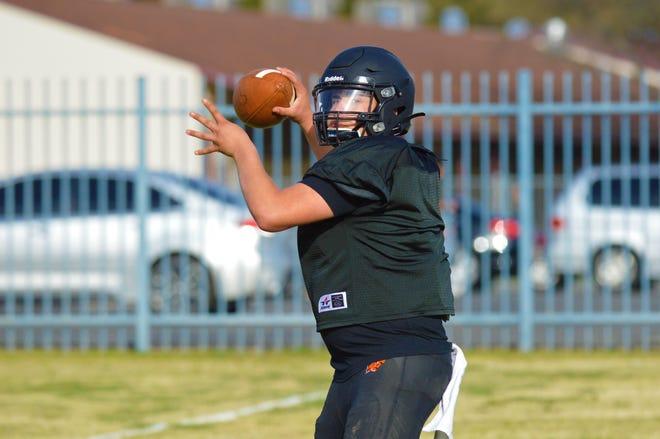 Woodlake Tigers quarterback  Junior Cervantespasses during practice on March 17, 2021 in Woodlake.